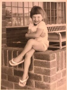 Young me sitting on a ledge
